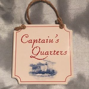White porcelain wall hanging. Captain's Quarters